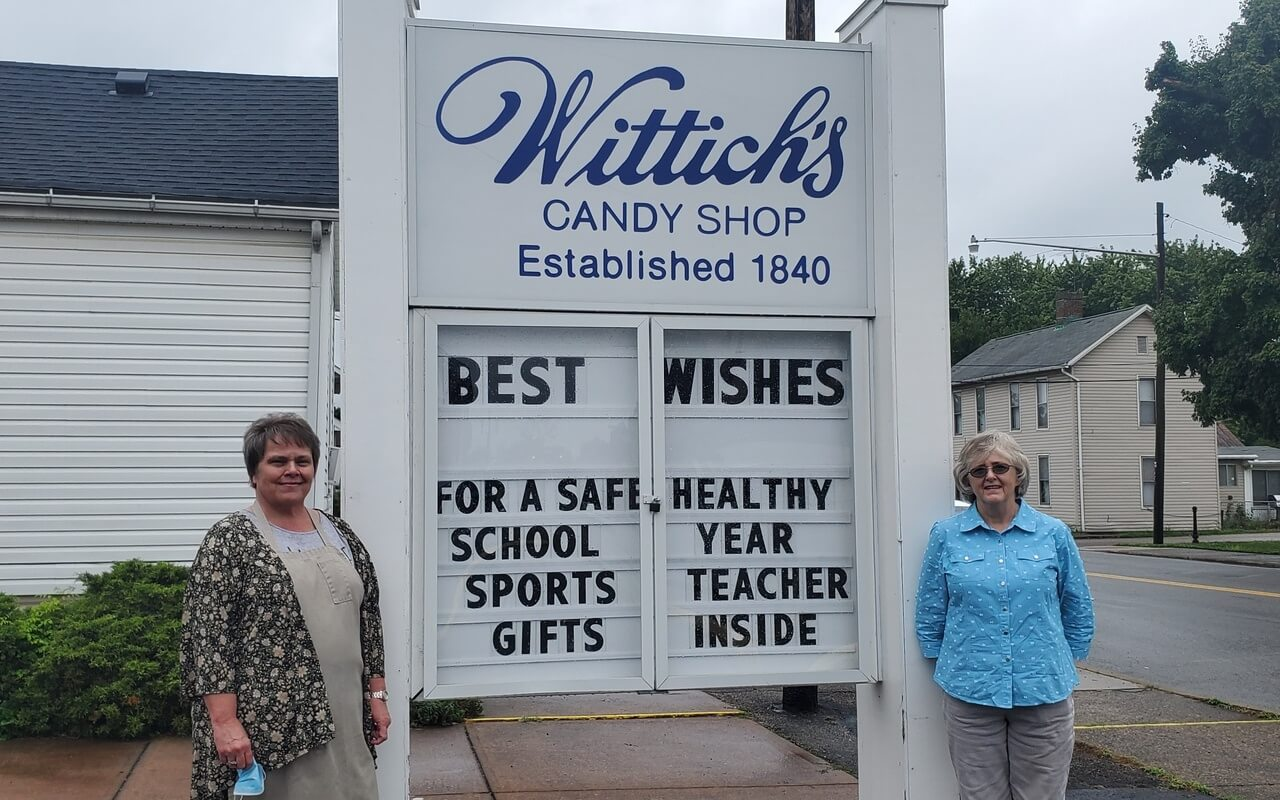 Janet Wittich and Tammy Ayers outside Wittich's Candy Shop